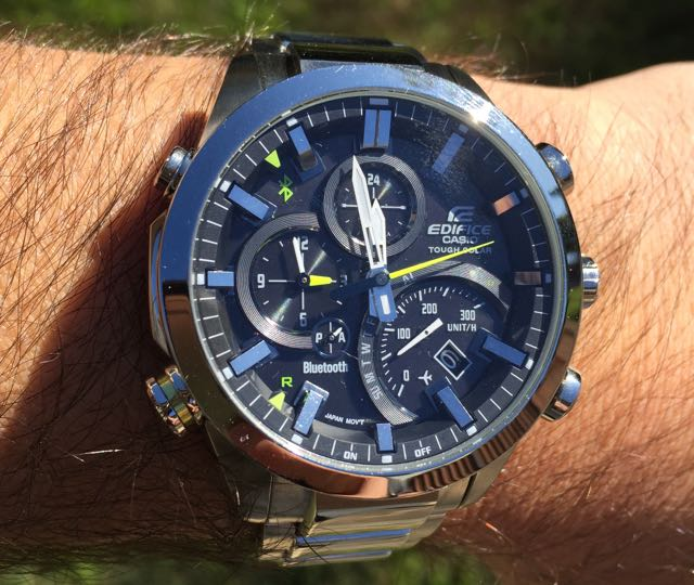The face of the Casio timepiece has hint of green on the second hand and  the world clock hand along with other small markings on the watch face. a5020f3915c